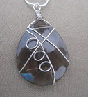 Smoke Glass Pendant Necklace Wrapped in Silver Wire from Joseph Genuardi Florist in Norristown, PA